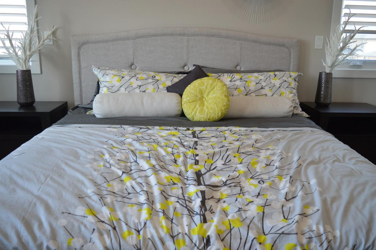 pretty bed with flowered comforter